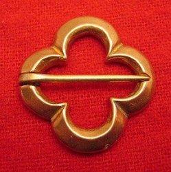 Annular Quatrefoil brooch
